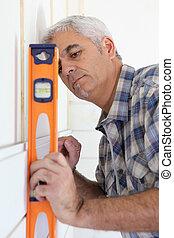 Handyman using spirit level