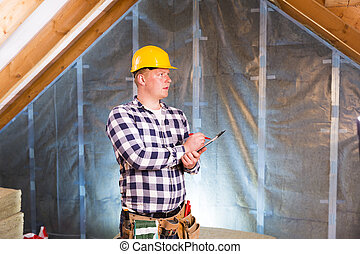 Handyman with a tool belt planning work, making to do list. House renovation service.