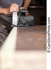 handyman with hand circular saw