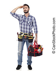 Handyman with toolbox looking into the distance