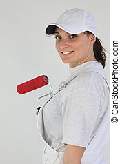 handywoman painting a wall