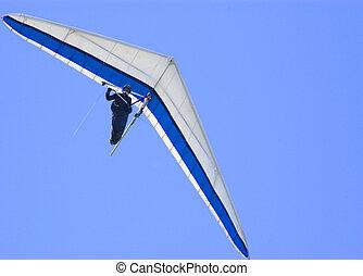 Hang glider - Blue hang glider against blue sky