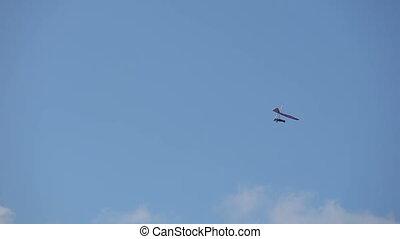 hang glider circling in the sky - hang glider circling fly...