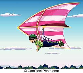 Hang glider flying in sky