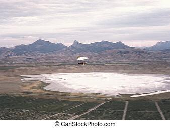 Hang glider. - Hang glider in flight. Clementyev mountain,...