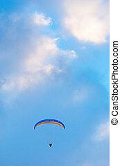 Hang glider - Hang gliding man on bright bue sky