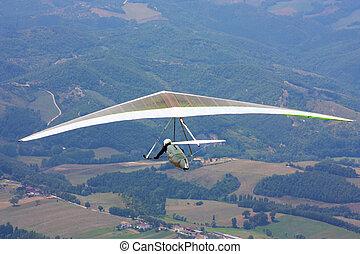 Hang glider in Italian mounta - Hang glider pilot in Italian...