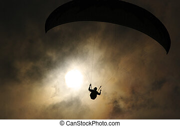Hang glider in the sun and beautiful sky