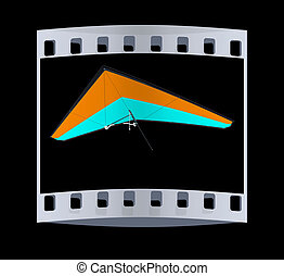 Hang glider isolated on a black background. The film strip