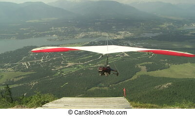 Hang Glider launching 01 - Hang gliding high above the...