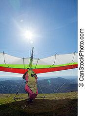 Hang glider launching off a mountain