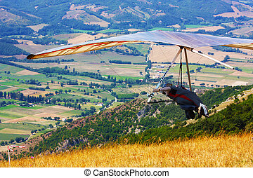 hang-glider taking of in the flight taken in Italy, Monte...