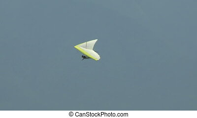 Hang Glider with windsock 06 - Hang gliding high above the...