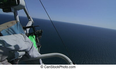 Hang-gliding over seashore