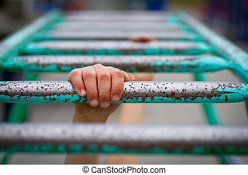 Hang on - Hand hanging on to monkey bars