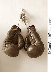 Hang up the gloves. - hang up the gloves, old worn leather...