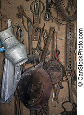 hanged old and rusty objects and tools