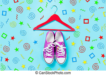hanger and purple gumshoes on the wonderful blue background in art pop style
