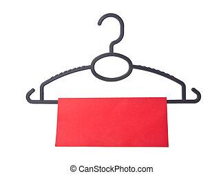 hanger. coat hanger with tag on background - hanger. coat ...