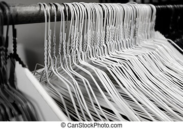 Hangers in a Row on a Bar for Hanging Clothing