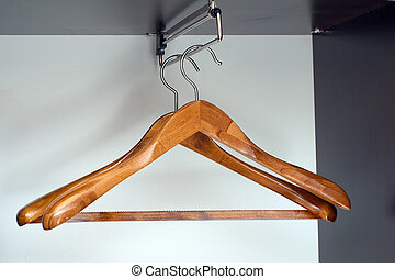 Hangers in closet - Pair of wooden hangers in empty closet