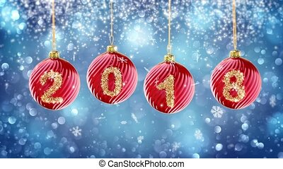 hanging 2018 number glitter Christmas balls on blue bokeh background. 4K