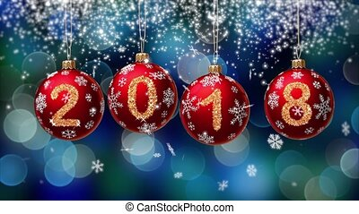 hanging 2018 number glitter Christmas balls on blue bokeh...