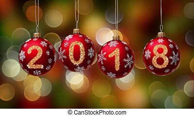 hanging 2018 number glitter Christmas balls on gold bokeh...