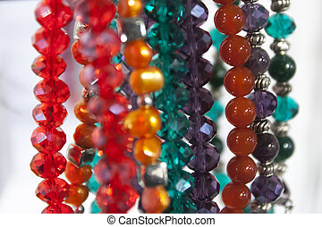 Hanging beautiful colorful bead necklaces in store.