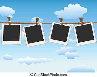 hanging Blank photo frames on blue sky