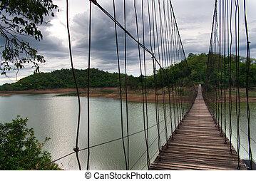 Hanging Bridge over the reservoir at sunset, Kang Krajarn National Park