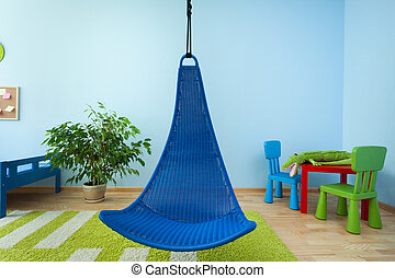 Hanging chair in child room