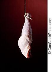 hanging chicken leg on red