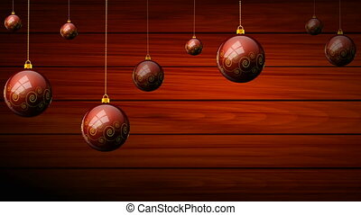 Hanging Christmas balls on a wooden background