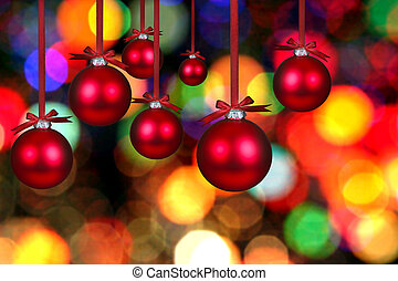 Hanging Christmas Bauble Bulbs Against Abstract Lights