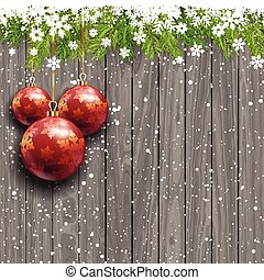 Christmas baubles on a wooden background