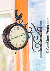 Hanging clock on the wall.