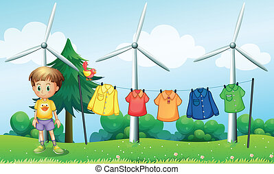 Hanging clothes at the hill near the windmills -...