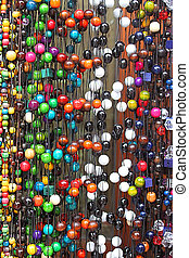 Hanging colourful beads and necklaces are sold by street vendor in Zakopane, Poland
