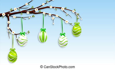 Hanging Easter eggs on a flowering branch - Hanging...