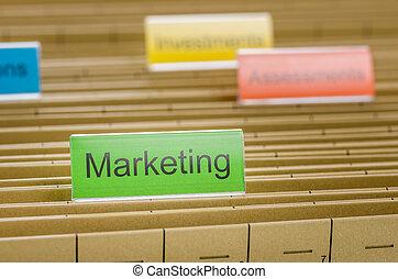 Hanging file folder labeled with Marketing