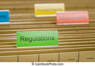 Hanging file folder labeled with Regulations