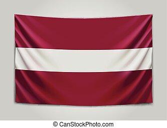 Hanging flag of Latvia. Republic of Latvia. Latvian national...
