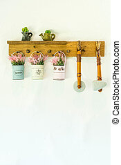 hanging flower pot on wall