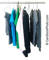 Garments hanging on coat hanger isolated against a white background