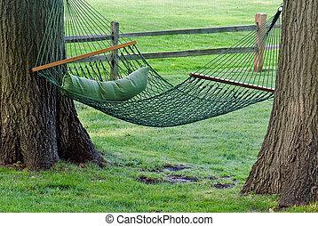 Hanging Hammock - Backyard hammock between two oak trees.