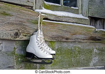 hanging ice skates - Ice skates hanging from old barn...
