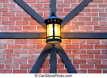 Hanging lamp on brick wall
