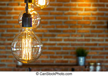 Hanging lamp with a brick wall backdrop block.