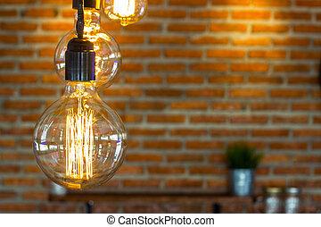 Hanging lamp with a brick wall backdrop block.
